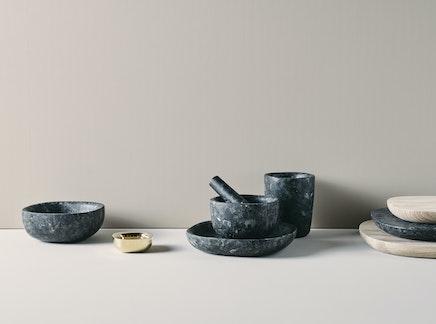 Bowl, tray and mortar in dark natural stone