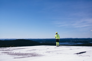 A Lundhs employee on the top of a with a view over Larvik